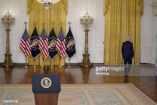 President Joe Biden, right, exits after speaking in the East Room of the White House in Washington, D.C., U.S., on Thursday, Sept. 16, 2021. Biden is...
