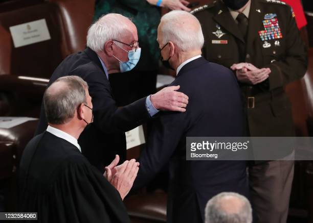 President Joe Biden, right, greets Senator Bernie Sanders, an Independent from Vermont, while arriving to speak during a joint session of Congress at...