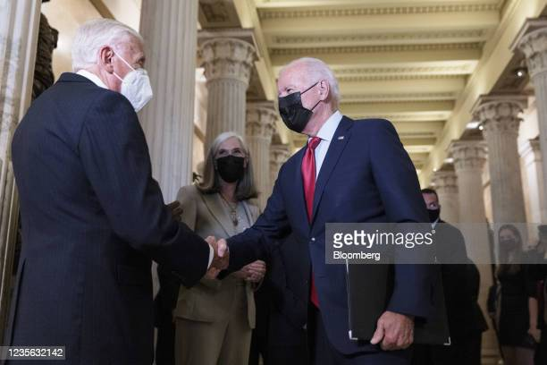 President Joe Biden, right, shakes hands with House Majority Leader Steny Hoyer, a Democrat from Maryland, before a House Democratic caucus meeting...