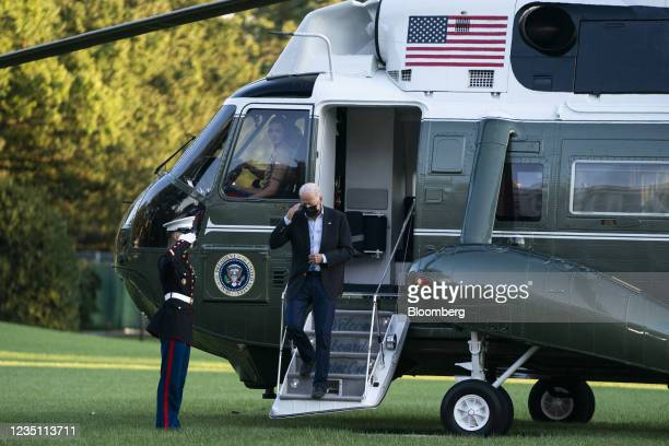 President Joe Biden salutes after arriving on Marine One on the South Lawn of the White House in Washington, D.C., U.S., on Tuesday, Sept. 7, 2021....