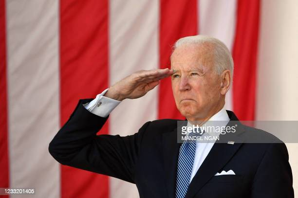 President Joe Biden salutes before delivering an address at the 153rd National Memorial Day Observance at Arlington National Cemetery on Memorial Day...