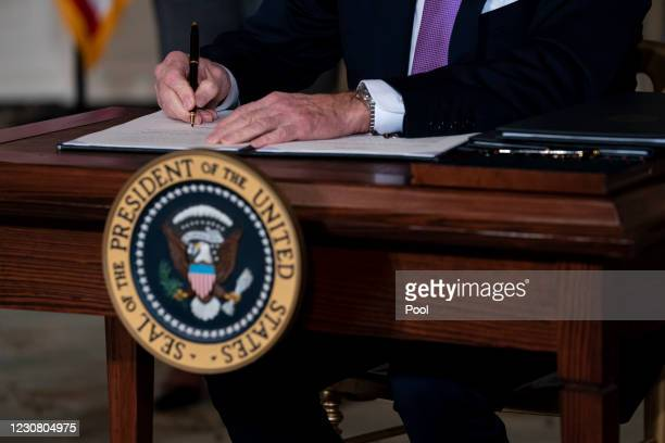 President Joe Biden signs executives orders related to his racial equity agenda in the State Dining Room of the White House on January 26, 2021 in...