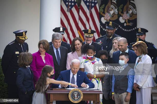 President Joe Biden signs H.R. 3325 during a ceremony in the Rose Garden of the White House in Washington, D.C., U.S., on Thursday, Aug. 5, 2021....