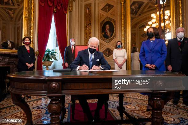 President Joe Biden signs three documents including an Inauguration declaration, cabinet nominations and sub-cabinet noinations, as US Vice President...