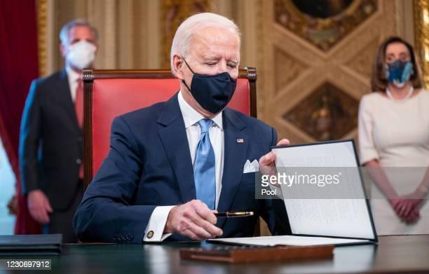 President Joe Biden signs three documents including an Inauguration declaration, cabinet nominations and sub-cabinet noinations in the Presidents...