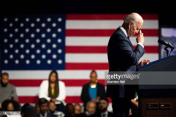 President Joe Biden silently prays during a moment of silence during commemorations of the 100th anniversary of the Tulsa Race Massacre on June 01,...