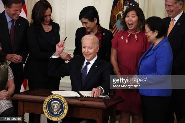 President Joe Biden smiles after signing the COVID-19 Hate Crimes Act into law, as Sen. Richard Blumenthal , Vice President Kamala Harris, Rep. Judy...