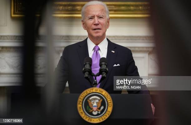 President Joe Biden speaks about the Covid-19 response before signing executive orders in the State Dining Room of the White House in Washington, DC,...