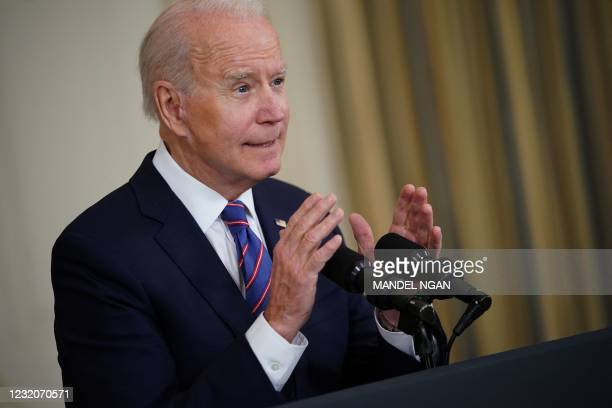 President Joe Biden speaks about the March jobs report in the State Dining Room of the White House in Washington, DC, on April 2, 2021. - The US...