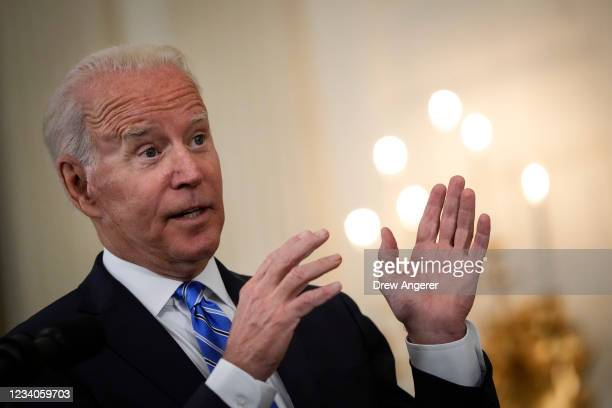 President Joe Biden speaks about the nation's economic recovery amid the COVID-19 pandemic in the State Dining Room of the White House on July 19,...
