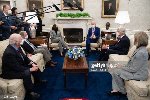 President Joe Biden speaks alongside US Vice President Kamala Harris , as he holds a meeting with US Senators, including Ben Cardin , Democrat of...