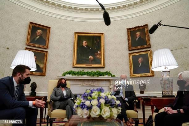 President Joe Biden speaks as Director of the National Economic Council Brian Deese, Vice President Kamala Harris, and Secretary of the Treasury...