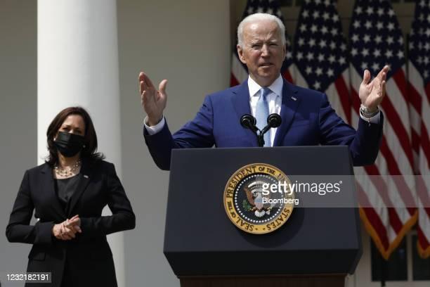 President Joe Biden speaks as U.S. Vice President Kamala Harris, left, listens in the Rose Garden of the White House in Washington, D.C., U.S., on...