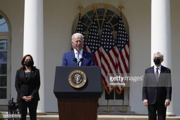 President Joe Biden speaks as U.S. Vice President Kamala Harris, left, and Merrick Garland, U.S. Attorney general, right, listen in the Rose Garden...