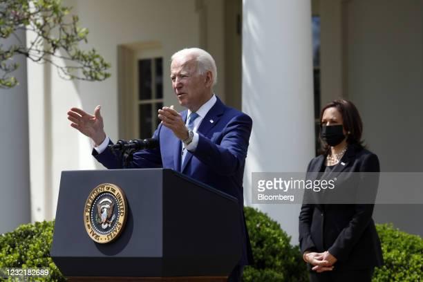 President Joe Biden speaks as U.S. Vice President Kamala Harris, right, listens in the Rose Garden of the White House in Washington, D.C., U.S., on...