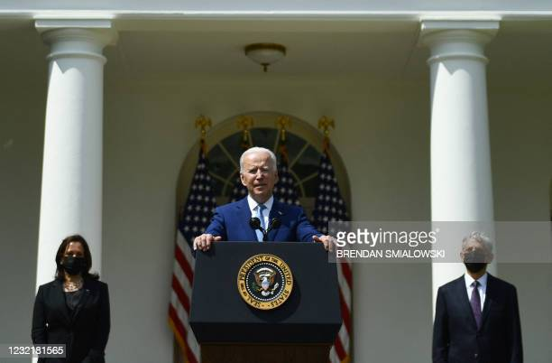 President Joe Biden speaks as Vice President Kamala Harris and Attorney General Merrick Garland look on during an event about gun violence prevention...