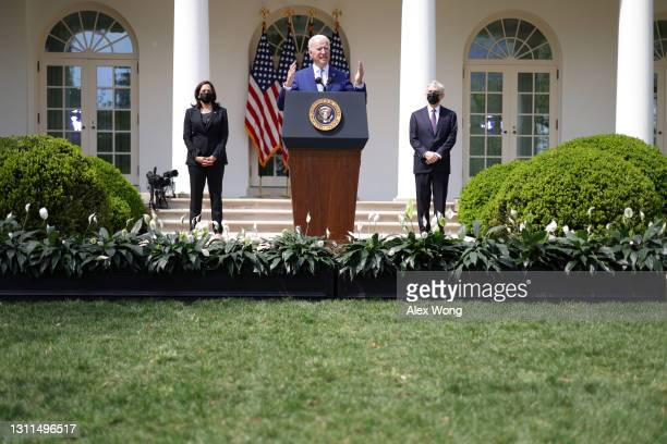 President Joe Biden speaks as Vice President Kamala Harris and Attorney General Merrick Garland listen during an event on gun control in the Rose...