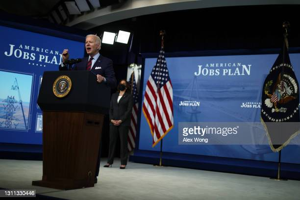 President Joe Biden speaks as Vice President Kamala Harris listens during an event at the South Court Auditorium at Eisenhower Executive Office...