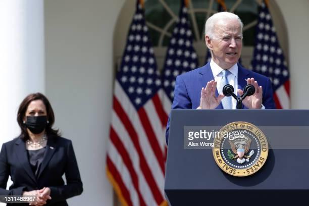 President Joe Biden speaks as Vice President Kamala Harris listens during an event on gun control in the Rose Garden at the White House April 8, 2021...