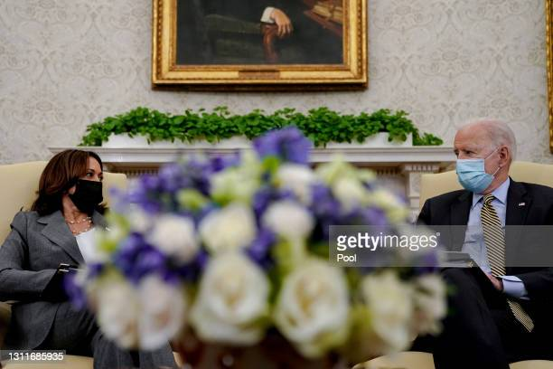 President Joe Biden speaks as Vice President Kamala Harris listens during the weekly economic briefing in the Oval Office at the White House on April...
