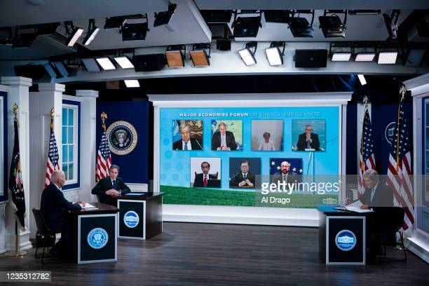 President Joe Biden speaks during a conference call on climate change with the Major Economies Forum on Energy and Climate, as U.S. Secretary of...