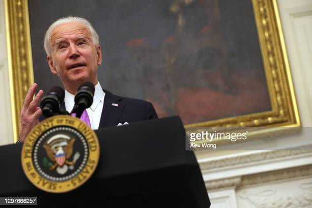 President Joe Biden speaks during an event in the State Dining Room of the White House January 21, 2021 in Washington, DC. President Biden delivered...