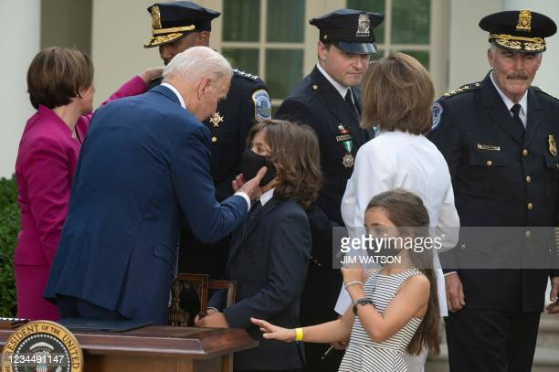 """President Joe Biden speaks to Logan Evans , son of the late U.S. Capitol Police officer William """"Billy"""" Evans, at the White House in Washington, DC,..."""