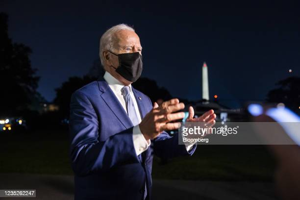 President Joe Biden speaks to members of the media after he arrived on the South Lawn of the White House in Washington, D.C., U.S., on Tuesday, Sept....