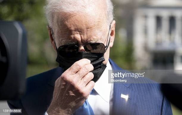 President Joe Biden speaks to members of the media on the South Lawn of the White House before boarding Marine One in Washington, D.C., U.S., on...