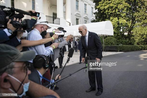 President Joe Biden speaks to members of the media outside of the White House before boarding Marine One in Washington, D.C., U.S., on Friday, July...