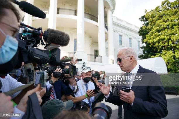 President Joe Biden speaks to reporters before boarding Marine One on the South Lawn of the White House in Washington DC on July 30, 2021. - Biden is...