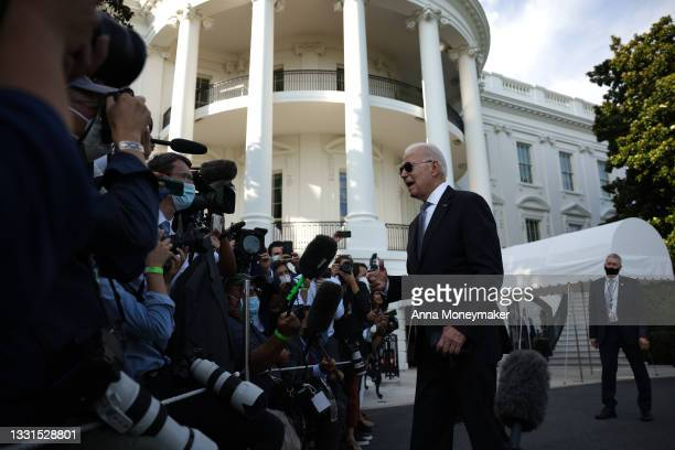 President Joe Biden speaks to reporters before walking to Marine One for a departure from the South Lawn of the White House on July 30, 2021 in...