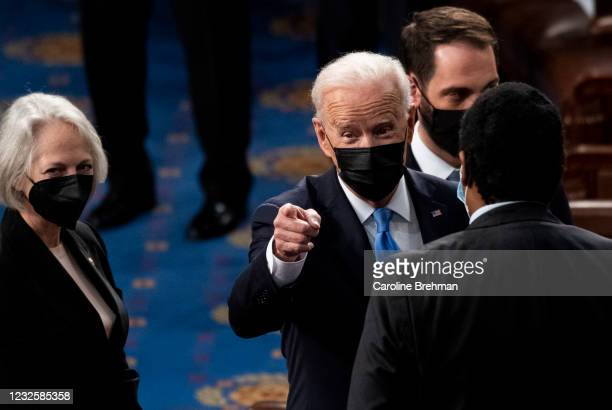 President Joe Biden speaks with lawmakers as he exits the House chamber at the end of his address to the joint session of Congress on Wednesday,...