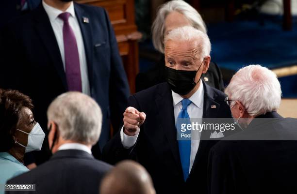 President Joe Biden speaks with lawmakers as he exits the House chamber at the end of his address to the joint session of Congress in the House...
