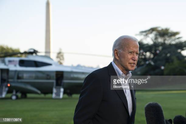 President Joe Biden speaks with members of the media on the South Lawn of the White House after arriving on Marine One in Washington, D.C., U.S., on...