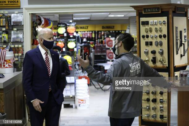 President Joe Biden speaks with Mike Siegel, co-owner of W.S. Jenks & Son, right, during a visit to the hardware store in Washington, D.C., U.S., on...