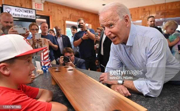 President Joe Biden speaks with people before getting ice cream at Moomers Homemade Ice Cream in Traverse City, Michigan on July 3, 2021.