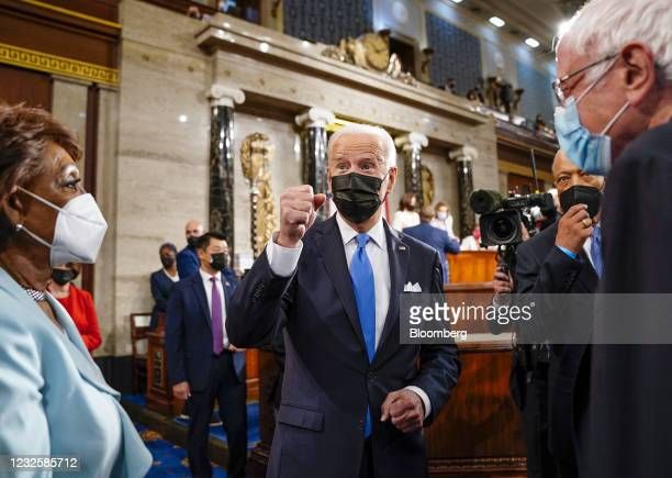 President Joe Biden speaks with Representative Maxine Waters, a Democrat from California, left, and Senator Bernie Sanders, an Independent from...