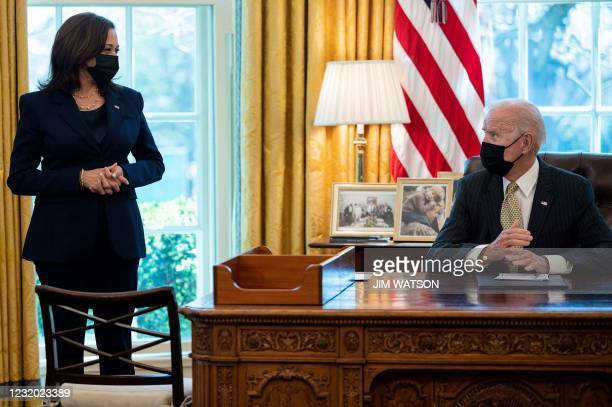 President Joe Biden speaks with US Vice President Kamala Harris after signing the Paycheck Protection Program Extension Act of 2021 into law at the...