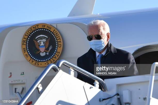 President Joe Biden steps off Air Force One upon arrival at Andrews Air Force Base in Maryland on February 8, 2021. - President Biden is returning to...