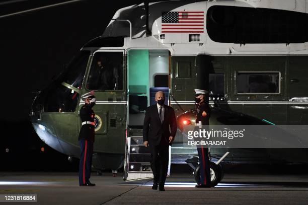 President Joe Biden steps off Marine One after a series of meetings in Atlanta, Georgia, on March 19, 2021. - President Biden leaves Atlanta,...