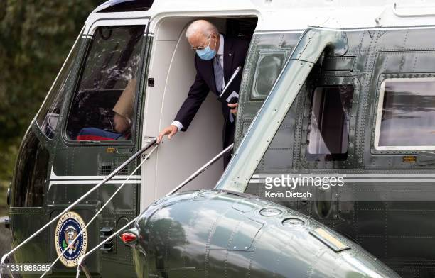 President Joe Biden steps off Marine One as he returns to the White House on August 02, 2021 in Washington, DC. President Biden is returning from a...
