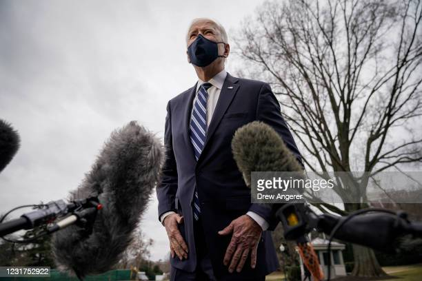 President Joe Biden stops briefly to talk to the press as he walks toward Marine One on the South Lawn of the White House on March 16, 2021 in...