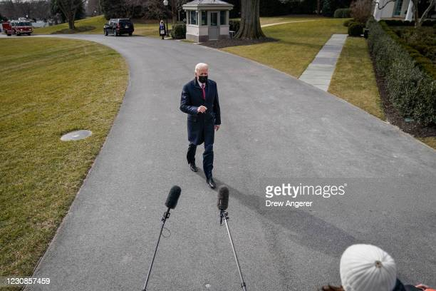 President Joe Biden stops to briefly speak with reporters on his way to Marine One on the South Lawn of the White House on January 29, 2021 in...