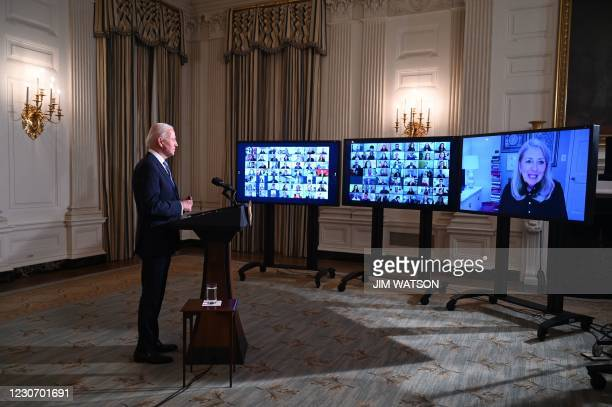 President Joe Biden swears in presidential appointees during a virtual ceremony, as the Director of the White House Office of Presidential Personnel...