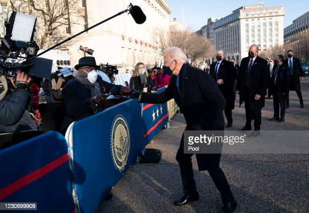 President Joe Biden talks with NBC anchor Al Roker as he and and First Lady Dr. Jill Biden walk along Pennsylvania Avenue in front of the White House...