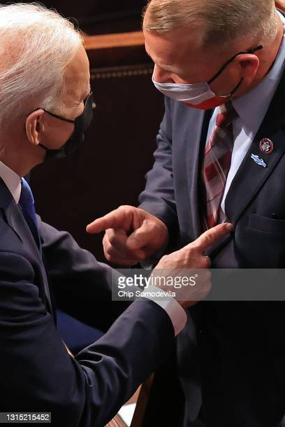 President Joe Biden talks with Rep. Troy Nehls after Biden addressed a joint session of Congress in the House Chamber in the U.S. Capitol April 28,...