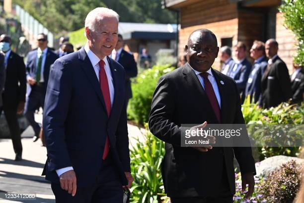 President Joe Biden talks with South Africa's President Cyril Ramaphosa at the G7 summit in Carbis Bay on June 12, 2021 in Carbis Bay, Cornwall. UK...