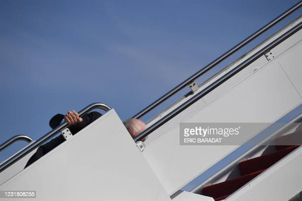 President Joe Biden trips as he boards Air Force One at Joint Base Andrews in Maryland on March 19, 2021. - President Biden travels to Atlanta,...