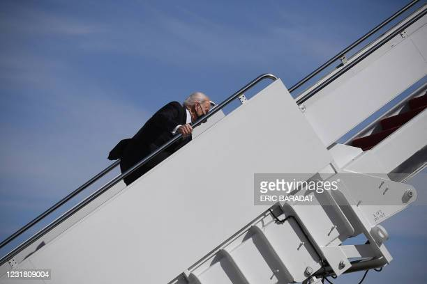 President Joe Biden trips while boarding Air Force One at Joint Base Andrews in Maryland on March 19, 2021. - President Biden travels to Atlanta,...